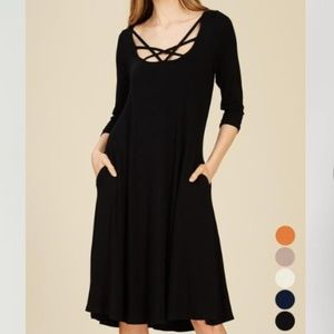 3/4 sleeve dress w/ front neck detail and pockets!